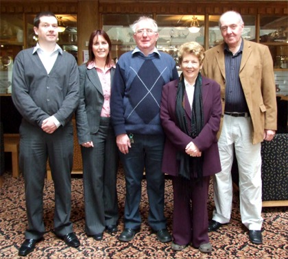 Jim Henderson, centre, with wife Sally and from left, Buncrana Town Clerk Seamus Canning, Samantha Nolan, incoming revenue collector, and retired Town Clerk Paul Doyle.