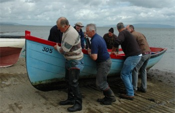 End of an era...Foyle drift netters haul their boats ashore. Photo courtesy BBC.